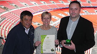 Sustainability Manager for Wembley Stadium, James Huartson and Green Team members Jane Baker and Henry Munro with the award