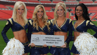 The St Louis Rams cheerleaders with their Wembley Way stone