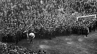 Billie the white horse holds back the crowds at the 1923 FA Cup Final