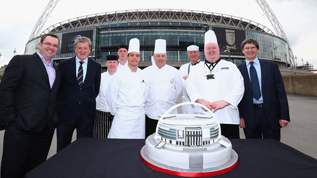 England manager Roy Hodgson takes to Wembley Way to cut Wembley's 90th birthday cake