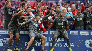 Rotherham celebrate promotion back to the Championship
