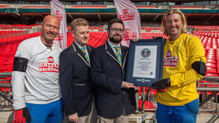 Robbie Savage with his Guinness World Record certificate