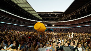 A giant duck bounces around the crowd at the 2014 Capital Summertime Ball