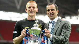Ben Watson and Roberto Martinez celebrate winning the 2013 FA Cup
