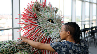 Artist Faith Bebbington puts the finishing touches to one of the lions